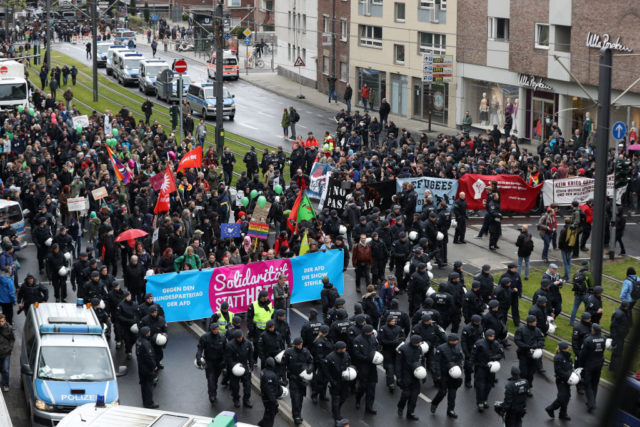 COLOGNE, GERMANY - APRIL 22: Protesters demonstrating against the right-wing populist Alternative for Germany (AfD) political party federal congress on April 22, 2017 in Cologne, Germany. Up to 50,000 people were expected to participate in the protests against the AfD, which is holding its federal congress of delegates following the recent surprise announcement by its chairwoman Frauke Petry that she will not run in German federal elections scheduled for September. The AfD saw a surge in popularity that helped it capture seats in 10 state parliaments, though more recently that party has seen its poll numbers slip. It has also been plagued by infighting between more moderate and radical factions of its leadership. (Photo by Maja Hitij/Getty Images)