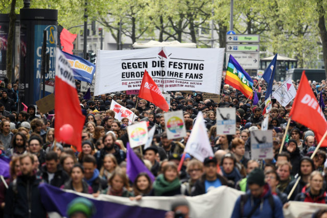 COLOGNE, GERMANY - APRIL 22: Protesters demonstrating against the right-wing populist Alternative for Germany (AfD) political party federal congress on April 22, 2017 in Cologne, Germany. Up to 50,000 people were expected to participate in the protests against the AfD, which is holding its federal congress of delegates following the recent surprise announcement by its chairwoman Frauke Petry that she will not run in German federal elections scheduled for September. The AfD saw a surge in popularity that helped it capture seats in 10 state parliaments, though more recently that party has seen its poll numbers slip. It has also been plagued by infighting between more moderate and radical factions of its leadership. (Photo by Lukas Schulze/Getty Images)