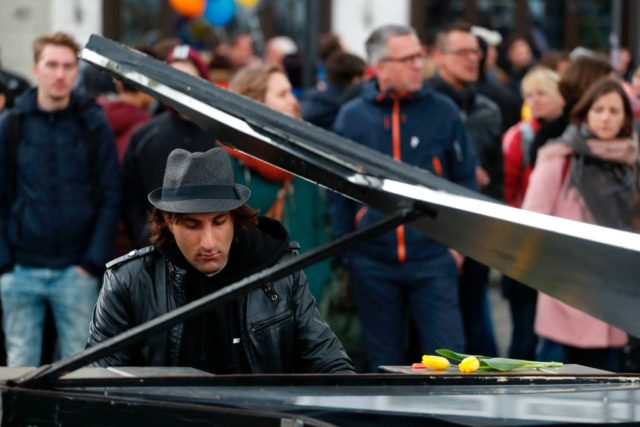A demonstrator plays piano during a protest against the party congress of Germany's right-wing populist Alternative for Germany (AfD) in Cologne, western Germany, on April 22, 2017. The anti-immigration party, which hopes to win its first seats in the national parliament in a general election in September, will gather in the western city of Cologne on April 22-23, 2017. / AFP PHOTO / Odd ANDERSEN (Photo credit should read ODD ANDERSEN/AFP/Getty Images)
