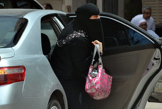 RIYADH - MAY 26:  A Saudi woman gets out of a car after being given a ride by her driver in Riyadh on May 26, 2011 as a campaign was launched on Facebook calling for men to beat Saudi women who drive their cars in a planned protest next month against the ultra-conservative kingdom's ban on women taking the wheel.  (Photo by FAYEZ NURELDINE/AFP/Getty Images)