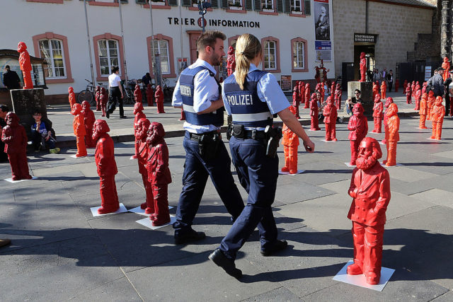 TRIER, GERMANY - MAY 05:  Police walk among some of the 500, one meter tall statues of German political thinker Karl Marx on display on May 5, 2013 in Trier, Germany. The statues, created by artist Ottmar Hoerl, are part of an exhibition at the Museum Simeonstift Trier commemorating the 130th anniversary of the death of Marx in 1883. Marx, who was born in Trier, is the author of The Communist Manifesto, and his ideas on the relationship between labour, industry and capital created the ideological foundation for socialist and communist movements across the globe.  (Photo by Hannelore Foerster/Getty Images)