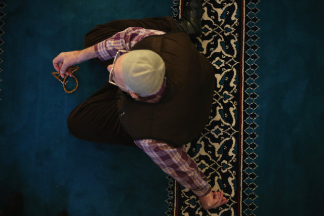 """BERLIN, GERMANY - JANUARY 09:  A Muslim man with prayer beads attends midday Friday prayers at the Turkish-speaking Sehitlik Mosque on January 9, 2015 in Berlin, Germany. The mosque's imam called the recent attacks by Islamic extremists against the satirical magazine Charlie Hebdo in Paris, in which 12 people were killed, a """"crime against humanity."""" The Sehitlik Mosque has been among the most outspoken in Germany against the attacks.  (Photo by Sean Gallup/Getty Images)"""