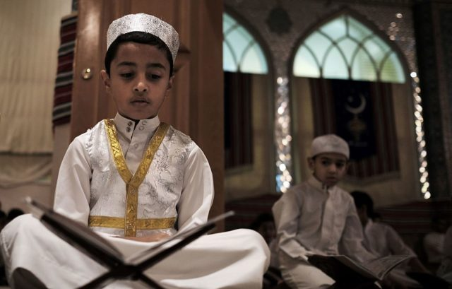 Bahraini Muslim boys read the Koran, Islam's holy book, during the holy fasting month of Ramadan at a mosque in the village of Sanabis, west of Manama, on June 18, 2016.  / AFP / MOHAMMED AL-SHAIKH        (Photo credit should read MOHAMMED AL-SHAIKH/AFP/Getty Images)