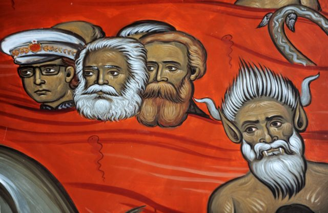 "This picture taken on January 31, 2014, shows a fresco with the portraits of late German philosophers Karl Marx (2nd L) and Friedrich Engels (3rd L), alongside Yugoslav communist leader Tito (L) and a demon (R), painted in an Orthodox church fresco scene of sinners in hell, in the newly-built ""Church of Resurrection"" in Podgorica. AFP PHOTO / SAVO PRELEVIC (Photo credit should read SAVO PRELEVIC/AFP/Getty Images)"
