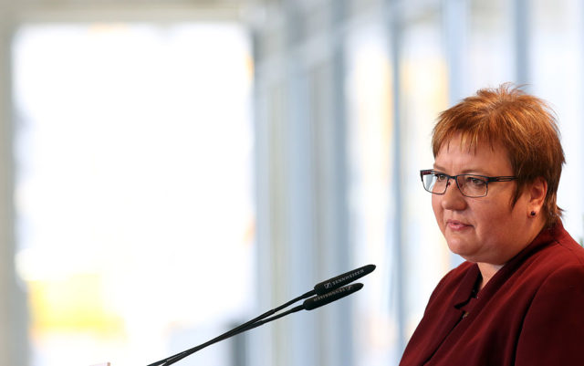 BERLIN, GERMANY - AUGUST 23:  Iris Gleicke, the German government's representative for the 'new,' or Former East German states, speaks at an event to celebrate the 25th anniversary of the ratification of the treaty on German reunification by a vote by the first and only freely-elected legislature, or Volkskammer, of the German Democratic Republic (GDR), also known as East Germany, a decision later to be confirmed by the Bundestag in Bonn that effectively ended the existence of the GDR, on August 23, 2015 in Berlin, Germany. The commemoration event took place inside the construction site for the city's new reconstruction of the Stadtschloss, or Prussian city palace, originally located on the site prior to its post-World War II remains being destroyed in order to be replaced by the Palast der Republik, or Palace of the Republic, which housed meetings of the Volkskammer, its housing structure itself destroyed in 2008 to make room for the new replica of the original castle building.  (Photo by Adam Berry/Getty Images)