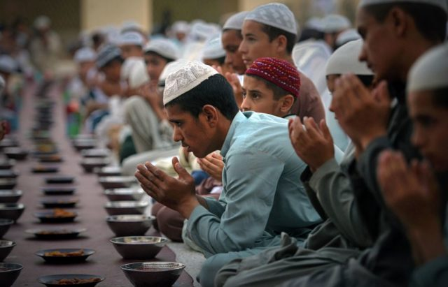 Pakistani Muslims pray before the break of fast at the start of holy month of Ramadan at a mosque in Peshawar on May 27, 2017. / AFP PHOTO / ABDUL MAJEED        (Photo credit should read ABDUL MAJEED/AFP/Getty Images)