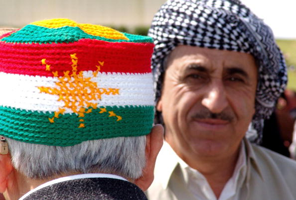 Arbil, IRAQ:  A Kurdish man wears a knitted hat with the Kurdish national flag during a memorial festival for the late Sheikh Mahmood Alhafeed, in the northern Kurdish city of Arbil, 11 April 2006.  Alhafeed, leader of the Kurdish national liberation movement, died in 1956 after returning from exile in India. AFP PHOTO/SAFIN HAMED  (Photo credit should read SAFIN HAMED/AFP/Getty Images)