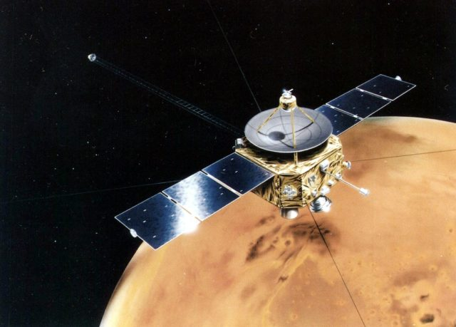 """KAGOSHIMA, JAPAN:  An artist rendition of the Mars orbiter Planet-B craft moving around Mars released 04 July. Japan successfully launched its first Mars orbiter mission rocket 04 July to investigate the upper atmosphere and its interaction with the solar wind and named the Mars spacecraft """"Nozomi"""" meaning hope in Japanese.   AFP PHOTO/Jiji Press (Photo credit should read AFP/Getty Images)"""