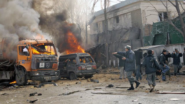 Afghan policemen gather at the site of a suicide attack in front of the German embassy in Kabul on January 17, 2009. A suicide bomb exploded near the German embassy in the Afghan capital, leaving people dead and wounded, the defence ministry said. The explosion -- in an area near UN offices and a US military base -- set alight a tanker and two vehicles, an AFP reporter at the scene said. AFP PHOTO/Massoud HOSSAINI (Photo credit should read MASSOUD HOSSAINI/AFP/Getty Images)