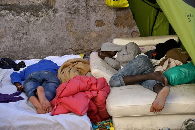 Migranten in Rom, Italien. Foto: FILIPPO MONTEFORTE/AFP/Getty Images