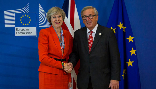 BRUSSELS, BELGIUM - OCTOBER 21: British Prime Minister Theresa May (L) shakes hands with President of the European Commission Jean-Claude Juncker (R) at the European Commission at the end of a two day summit at the Council of the European Union on October 21, 2016 in Brussels, Belgium. Theresa May is attending her first EU Council meeting as the British Prime Minister. The government's Brexit strategy continues to be debated in the UK with Article 50 of the Lisbon treaty to be triggered by the end of March 2017.  Article 50 notifies the EU of a member state's withdrawal and the EU is then obliged to negotiate a withdrawal agreement. The process will take two years seeing the UK finally withdraw from the Union in March 2019. (Photo by Jack Taylor/Getty Images)