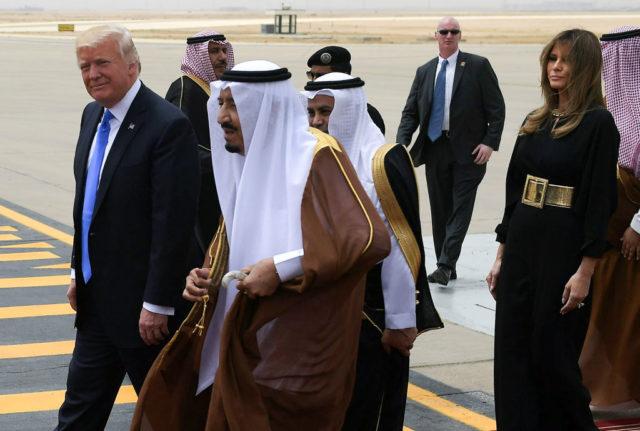 US President Donald Trump (L) is welcomed by Saudi King Salman bin Abdulaziz al-Saud (C) upon arrival at King Khalid International Airport in Riyadh on May 20, 2017, followed by First Lady Melania Trump (R). / AFP PHOTO / MANDEL NGAN        (Photo credit should read MANDEL NGAN/AFP/Getty Images)
