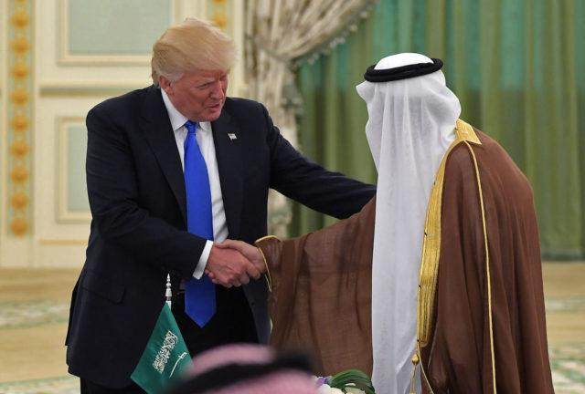 US President Donald Trump (L) shakes hands with Saudi Arabia's King Salman bin Abdulaziz al-Saud during a signing ceremony at the Saudi Royal Court in Riyadh on May 20, 2017. / AFP PHOTO / MANDEL NGAN        (Photo credit should read MANDEL NGAN/AFP/Getty Images)
