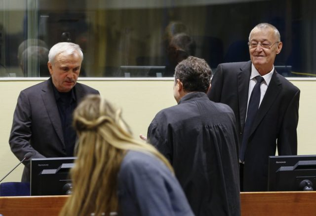 EDITORS NOTE: Graphic content / Former Serbian intelligence chiefs, Jovica Stanisic (L) and Franko Simatovic (R) appear in court as they go back on trial before a UN court in The Hague on June 13, 2017 at the United Nations Mechanism for International Criminal Tribunal, accused of running death squads that terrorised Bosnia and Croatia in the bloody 1990s Balkans wars. / AFP PHOTO / ANP / Michael Kooren / Netherlands OUT (Photo credit should read MICHAEL KOOREN/AFP/Getty Images)