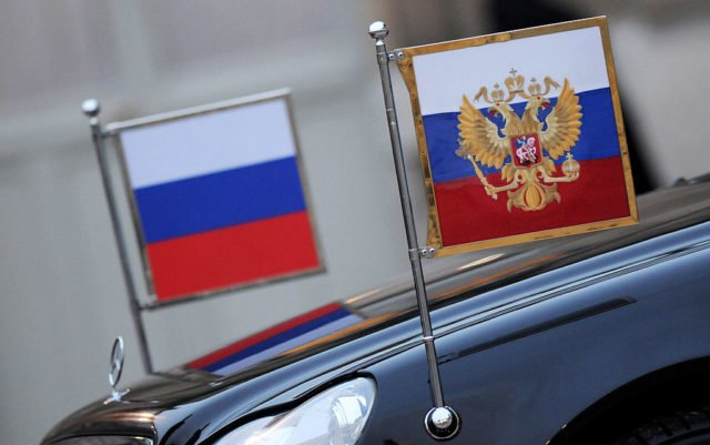 PARIS - MARCH 01: Russian flags on the official car of visiting President Dmitry Medvedev in the courtyard of the Elysee Palace on March 1, 2010 in Paris, France. Medvedev met with French President Nicolas Sarkozy during his three-day state visit to France.  (Photo by Pascal Le Segretain/Getty Images)