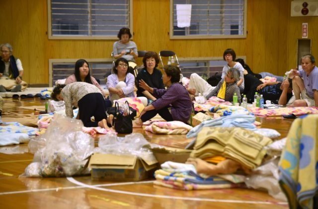Evacuated residents from a flooded area stay at a school in Hita, Oita prefecture on July 6, 2017. At least two people have been killed and about 20 others are missing in huge floods that are surging through southern Japan, with hundreds of thousands of people ordered or urged to flee. / AFP PHOTO / KAZUHIRO NOGI (Photo credit should read KAZUHIRO NOGI/AFP/Getty Images)