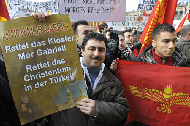 Members of the Syriac Orthodox church stage a demonstration outside Berlin's Cathedral (Berliner Dom) January 25, 2009. Thousands of Syriacs gathered to protest against the Turkish government's alleged mistreatment of the Syriac minority. They also claim the government is trying to expropriate the Syriac monastery of Mor Gabriel in Tur Abdin. AFP PHOTO JOHN MACDOUGALL (Photo credit should read JOHN MACDOUGALL/AFP/Getty Images)