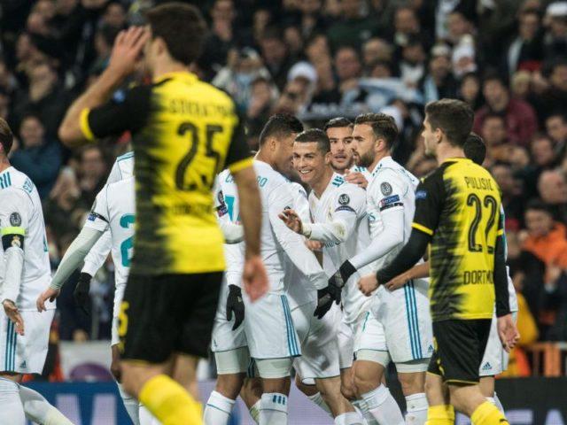 Cristiano Ronaldo (M) lässt sich für sein Tor feiern - die BVB-Spieler sind frustriert. Foto: Bernd Thissen/dpa