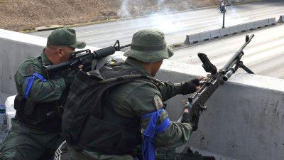 Regierungstreue Gangs wollen Maduro mit Waffengewalt verteidigen