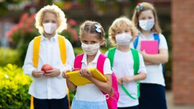 Gereiztheit und Kopfschmerzen: Häufigste Beschwerdesymptome bei Kindern mit Masken-Problemen